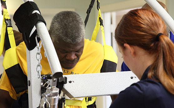 Catastrophic injury patient participates in one on one session with clinicians